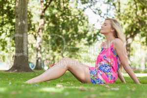 Gorgeous casual woman relaxing on a lawn