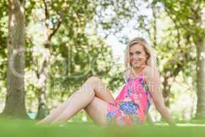 Gorgeous young woman posing on a lawn