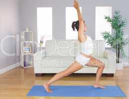 Sporty slim woman practicing yoga pose for stretching her body