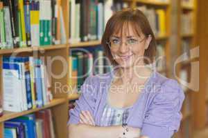 Mature intellectual woman posing in library