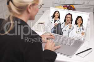 woman using laptop viewing three doctors with thumbs up