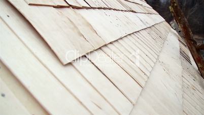 Cedar wooden shingle shake roof of the cabin log neatly done