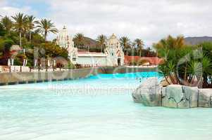 The tourists enjoying artificial wave water attractions in Siam waterpark, Tenerife, Spain