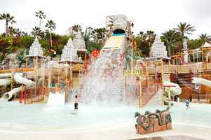 The kids playing in water attractions in Siam waterpark, Tenerife, Spain
