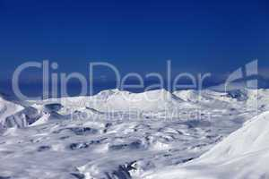 snowy plateau and off-piste slope at sun day