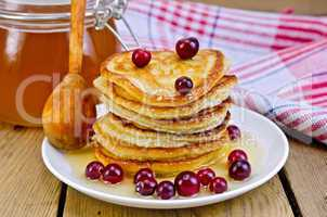 flapjacks with cranberry and spoon on board