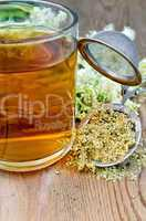 herbal tea from meadowsweet dry in a strainer with a mug
