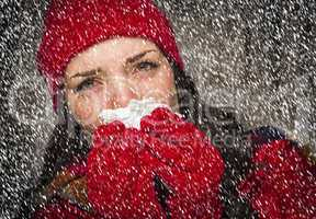 sick woman blowing her sore nose with tissue and snow