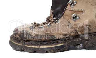 old trekking boot in mud