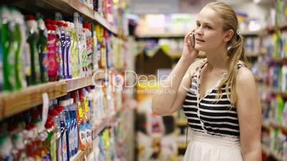 woman chatting on her mobile while out shopping
