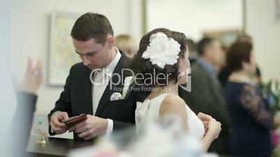 Bride and groom in register office.
