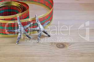 Decorative ribbon and stars as christmas decoration