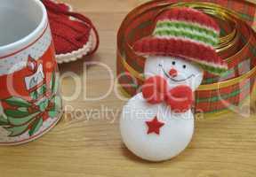 Mug with Christmas decor and santa claus toy