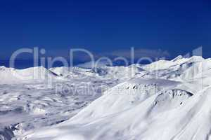 off-piste slope and snowy plateau at nice day