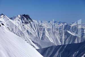 snowy winter mountains in haze