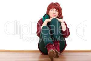 young woman sitting relaxed on the floor