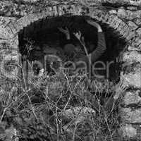 obscured figures in arched structure