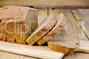 Rye homemade bread sliced on the board