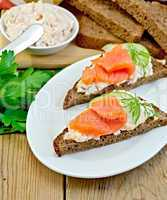 Sandwich with cream and salmon in the dish with dill