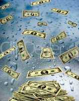 dollar banknotes lying on the wet glass