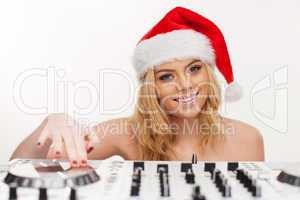 young brunette woman in christmas wear with dj equipment