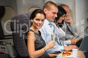 business travel by plane woman enjoy refreshment