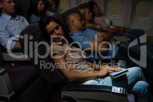 flight passengers sleep plane cabin night travel
