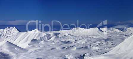 panoramic view on snowy plateau and blue sky at nice day