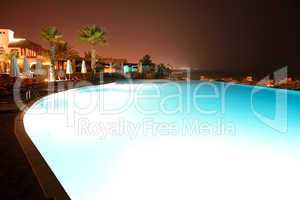 the swimming pool at luxury hotel in night illumination, ras al