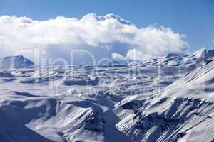 snowy plateau and blue sky with clouds at nice evening