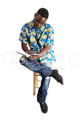 black man reading.