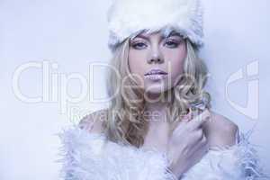 beautiful serene woman in cool blue winter fashion