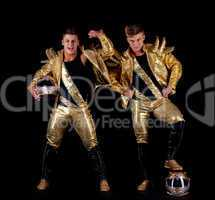 Handsome guys posing in golden dancing costumes