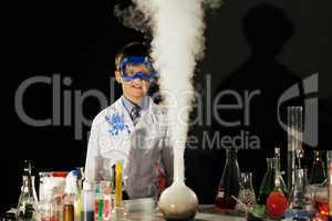 Surprised student looks at reaction of reagents