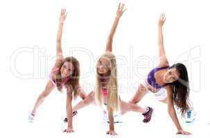Energetic smiling girls practiced in studio