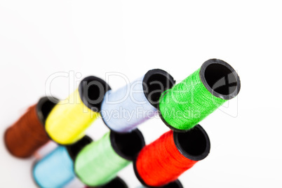pyramid of colourful cotton reels