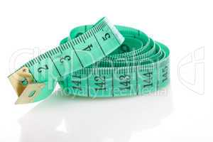 green measuring tape, symbol of accuracy, on white