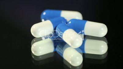 Medical capsules rotating.