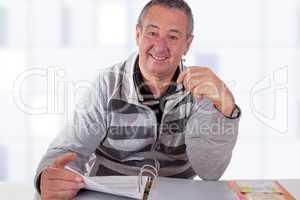 man with file folders