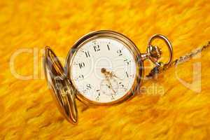 gold pocket watch on gold cover