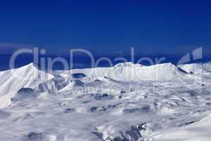 snowy plateau and blue sky