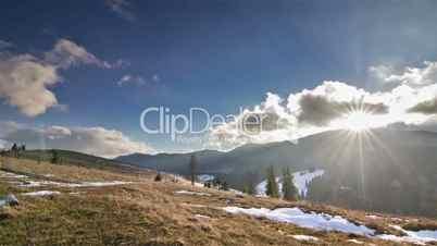 Sun over mountains time lapse