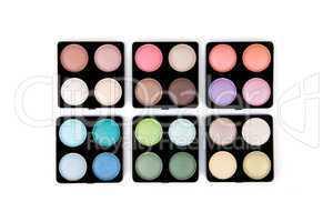 Six eyeshadow palettes isolated on white