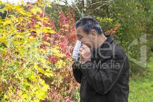 man with handkerchief in autumn