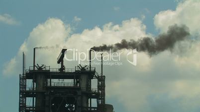 Industrial building with smoking chimneys.