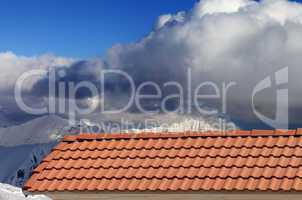 roof tiles and snowy mountains
