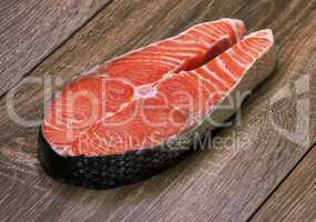 piece of a salmon on a wood