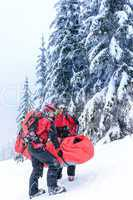 ski patrol carry injured person in stretcher