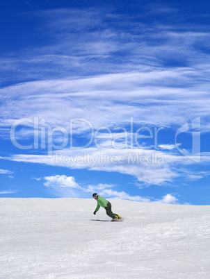 snowboarder on ski slope and blue sky