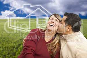 happy couple sitting in grass field with ghosted house behind